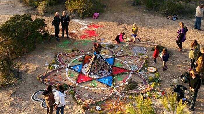 Manu had to climb a tree to try to capture the whole mandala, created for and with her from all of us.